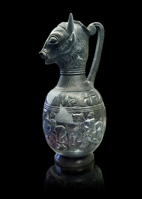 Side view of the 6th century BC Etruscan Bull headed bucherro style oinochoe, or wine jug,  made in Chuisi and excavated from the necropolis de Fonte Rotella, inv 3190, National Archaeological Museum Florence, Italy
