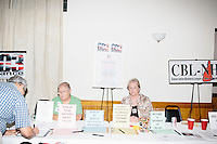 Members of the Conservative Business Leagure of New Hampshire sit at an informatoin table at the annual Coalition of New Hampshire Taxpayers Picnic at the Hillsborough American Legion #59 in Hillsborough, New Hampshire. Representatives from most of the candidates running for president were at the picnic, as were members of local conservative political groups.