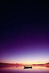The deep tones of the evening sky dominate the skiff off the Molokai coast, Hawaii.