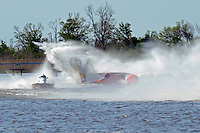Frame 7: Terry Rinker (#10) and Chris Fairchild (#62) race up the back stright to turn 2 where Rinker's boat rolls over a wake, noses in and flips.   (Formula 1/F1/Champ class)