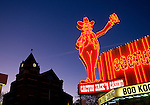 Neon sign on Cactus Jack's Casino at sunrise in Carson City, NV.