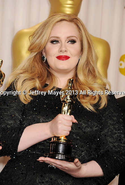 HOLLYWOOD, CA - FEBRUARY 24: Adele  poses in the press room the 85th Annual Academy Awards at Dolby Theatre on February 24, 2013 in Hollywood, California.