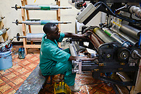 RWANDA, Kigali, plastic recycling at company Ecoplastics, machine for production of new plastic foils from recycled and new granules, repairing