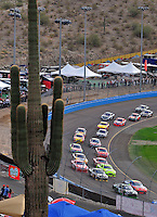 Nov. 9, 2008; Avondale, AZ, USA; NASCAR Sprint Cup Series driver Denny Hamlin (11) races alongside Jeff Gordon (24) during the Checker Auto Parts 500 at Phoenix International Raceway. Mandatory Credit: Mark J. Rebilas-