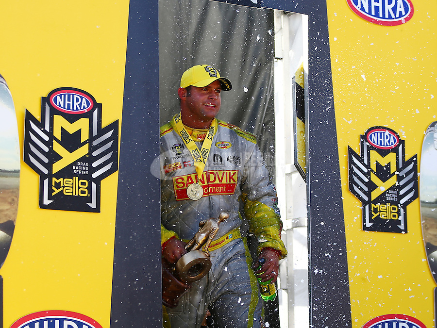 Feb 26, 2017; Chandler, AZ, USA; NHRA funny car driver Matt Hagan celebrates after winning the Arizona Nationals at Wild Horse Pass Motorsports Park. Mandatory Credit: Mark J. Rebilas-USA TODAY Sports