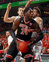 Louisville forward Montrezl Harrell (24) is defended by Virginia forward/center Mike Tobey (10) and Virginia forward Anthony Gill (13) during the first half of an NCAA basketball game Saturday Feb. 7, 2015, in Charlottesville, Va. (Photo/Andrew Shurtleff)