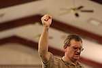 A Pentecostal man raises his fist in praise during an evening church service at Rockhouse Pentecostal Church in Hyden, Ky. on Wednesday, October 9, 2013. Photo by Adam Pennavaria