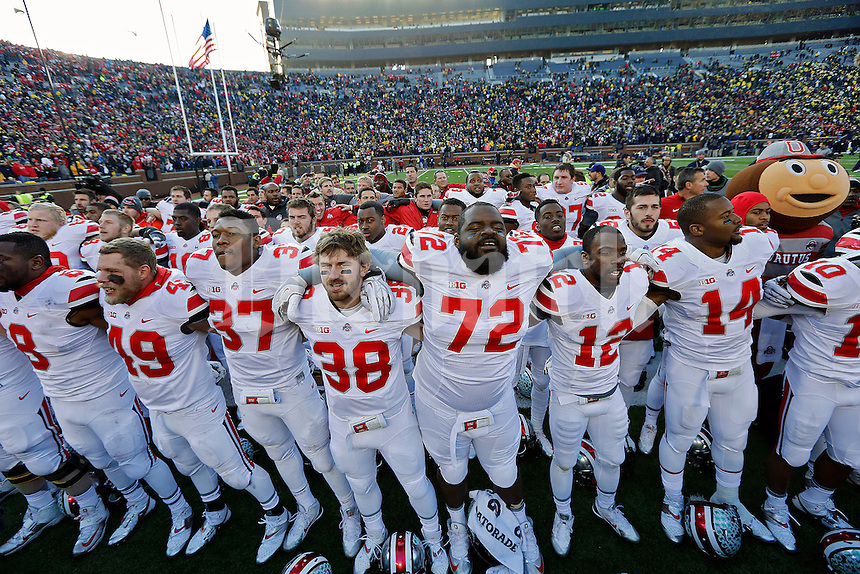 Ohio State Buckeyes sing Carmen Ohio  after beating Michigan Wolverines 42-41 during their college football game at Michigan Stadium in Ann Arbor, Michigan on November 30, 2013.  (Dispatch photo by Kyle Robertson)