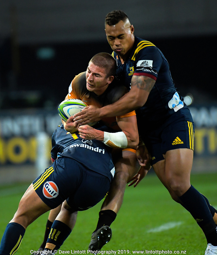 Jaguares' Sebastian Cancelliere is tackled during the Super Rugby match between the Highlanders and Jaguares at Forsyth Barr Stadium in Dunedin, New Zealand on Saturday, 11 May 2019. Photo: Dave Lintott / lintottphoto.co.nz