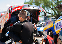 Apr 23, 2017; Baytown, TX, USA; NHRA funny car driver Jonnie Lindberg greets Ron Capps during the Springnationals at Royal Purple Raceway. Mandatory Credit: Mark J. Rebilas-USA TODAY Sports
