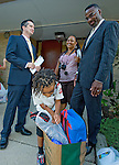 Photo by Phil Grout..Bond Mill Elementary School principal Justin FitzGerald chats with Sonja and Dwight Williams as their son David, 5, checks out his bag of school supplies for his very first day of school—ever.