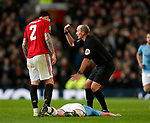 Kevin De Bruyne of Manchester City goes down injured following a clash with Victor Lindelof of Manchester United and referee Mike Dean calls for assistance during the Carabao Cup match at Old Trafford, Manchester. Picture date: 7th January 2020. Picture credit should read: Darren Staples/Sportimage