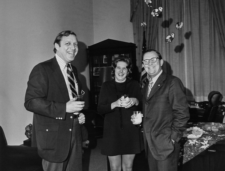 Congressman and staff member at a Christmas party. (Photo by Dev O'Neill/CQ Roll Call via Getty Images)