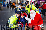 Enjoying a visit from Santa at the annual Garda music and street collection in the Mall on Monday.<br /> Kneeling: Gda Mary Gardiner, Oisin Burke and Santa.<br /> Standing: Gda Sean Grinnan and Gda Cathy Murphy.