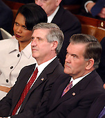 United States National Security Advisor Condoleezza Rice, left, White House Chief of Staff Andrew Card, center, and United States Secretary for Homeland Security Tom Ridge, right, listen as United States President George W. Bush delivers his State of the Union Address before a Joint Session of the United States Congress in the Capitol in Washington, DC on January 20, 2004.<br /> Credit: Ron Sachs / CNP