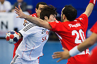 05 APR 2012 - LONDON, GBR - South Korea's Kyung-Soo Ko (KOR) (left, in white and red) finds his path to goal blocked by Tunisia's Haykel Megannem (TUN) (on right, in red and white) during the men's 2012 London Cup match at the National Sports Centre in Crystal Palace, Great Britain (PHOTO (C) 2012 NIGEL FARROW)
