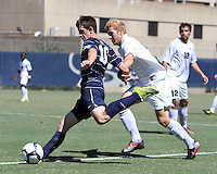 Jimmy Nealis #16 of Georgetown University swings a shot past Colin Givens #5 of Michigan State during an NCAA match at North Kehoe Field, Georgetown University on September 5 2010 in Washington D.C. Georgetown won 4-0.