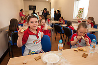 Megan Horbury, 6 and Amber Keeley, 5 sample the World Breads on offer