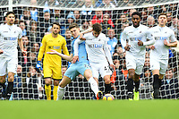 Manchester City's John Stones (left) Swansea City Tom Carroll (right) battle for possession during the Premier League match between Manchester City and Swansea City at the Etihad Stadium, Manchester, England. Sunday 05 February 2017