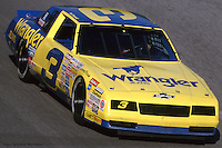 DAYTONA BEACH, FL - FEBRUARY 16: Dale Earnhardt drives his Wrangler Chevrolet during practice for the Daytona 500 on February 16, 1986, at the Daytona International Speedway in Daytona Beach, Florida.