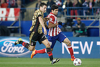 Atletico de Madrid's Diego Costa (r) and AC Milan's Daniele Bonera during Champions League 2013/2014 match.March 11,2014. (ALTERPHOTOS/Acero)