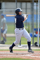 Outfielder Mike O'Neill (14) of the New York Yankees organization hits a home run during a minor league spring training game against the Toronto Blue Jays on March 16, 2014 at the Englebert Minor League Complex in Dunedin, Florida.  (Mike Janes/Four Seam Images)