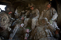 Four US Army soldiers from the 101st Airborne are treated by a medic on board a medevac helicopter from Charlie Company, Sixth Battalion, 101st Aviation Regiment near Kandahar, after their convey was ambushed with RPG and IEDs (improvised explosive devices).