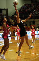 NZ's Irene Van Dyk beats Geva Mentor to a pass during the International  Netball Series match between the NZ Silver Ferns and World 7 at TSB Bank Arena, Wellington, New Zealand on Monday, 24 August 2009. Photo: Dave Lintott / lintottphoto.co.nz