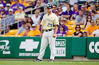 Wake Forest Demon Deacons coach Grant Achilles #29 coaches first base during the game against the LSU Tigers at Alex Box Stadium on February 20, 2011 in Baton Rouge, Louisiana.  The Tigers defeated the Demon Deacons 9-1.  Photo by Brian Westerholt / Four Seam Images