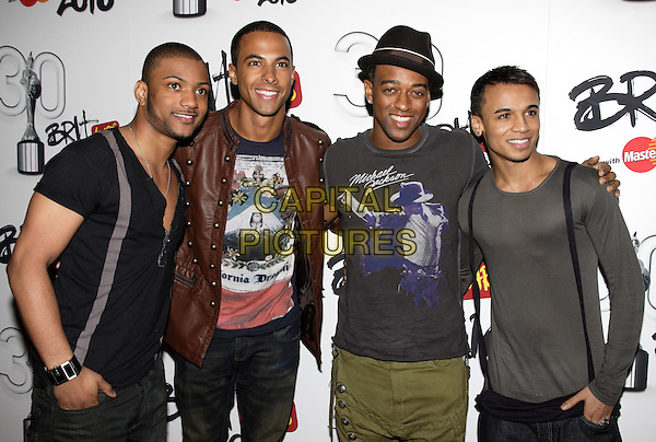"JLS - Jonathan ""JB"" Gill, Marvin Humes, Ortise WIlliams & Aston Merrygold.Brit Awards Nominations at Indigo O2, London, England, UK,.January 18th 2010..brits half length group boy band hat brown leather jacket grey gray Michael jackson t-shirt tee braces .CAP/ROS.©Steve Ross/Capital Pictures"