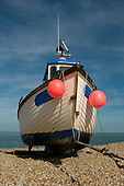 Fishing boat on the shingle beach at Dungeness, Kent.