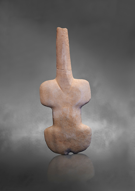 Ancient violin shaped schematic figure from the Pelos phase,  'Kusura type', probably from Asia Minor. Early Cycladic period I 3200-2800 BC. Museum of Cycladic Art Athens, Cat no 961. Grey Background.