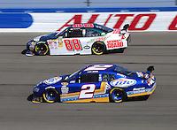 Oct. 11, 2009; Fontana, CA, USA; NASCAR Sprint Cup Series driver Kurt Busch (2) races alongside Dale Earnhardt Jr (88) during the Pepsi 500 at Auto Club Speedway. Mandatory Credit: Mark J. Rebilas-