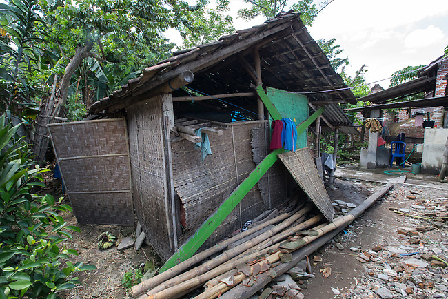 "5 April 2017, Surabaya,East Java,Indonesia: The goat shed where Febrianto, a 24 year old mental illness sufferer, was released from the chains he has been shackled to a stake for the past two years next to his family in Pehwetan village, East Java. Indonesian Social Affairs Dept. workers cut the bonds and washed his emaciated body and applied first aid before putting him in a strait jacket and taking him to a facility in Malang for treatment. Febrianto is a patient in a program called ""E- Shackling"" which aims to free people suffering from mental illness, from the shackles that family often place them in to control them in the wake of a lack of treatment options and which will treat them and enter them in a data base allowing them to be traced before releasing them back to their families. Some people stay chained to a stake or in rooms for years by their families and not all families are willing to take their sick family members back. Picture by Graham Crouch/The Australian"