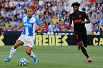 CD Leganes's Martin Braithwaite  and Atletico de Madrid's Thomas Teye during La Liga match between CD Leganes and Atletico de Madrid at Butarque Stadium in Madrid, Spain. August 25, 2019. (ALTERPHOTOS/A. Perez Meca)