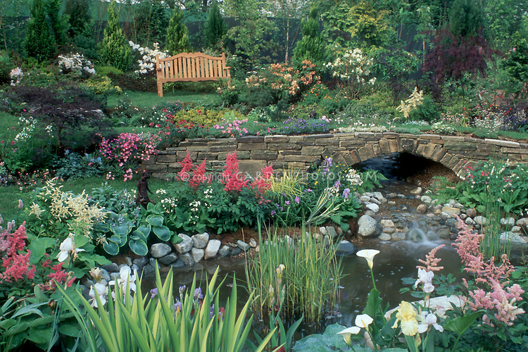 Beautiful Garden With Wooden Bench Waterfall Pond