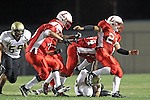 Lawndale, CA 10/01/10 - Brock Dale (Peninsula #7), Raymon Alvarado (C)  (Lawndale #21), Carlos Banuelos (Lawndale #10) and Aaron Fowler (Lawndale #5) in action during the Peninsula-Lawndale Varsity football game.