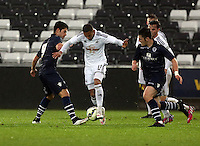 Pictured: Kenji Gorre of Swansea (C) Monday 30 March 2015<br />
