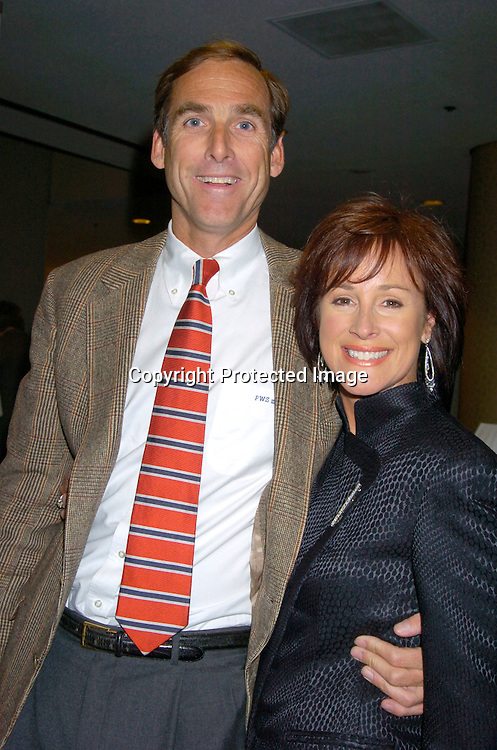 Hillary B Smith in Armani and husband..at HeartShare 's Annual Spring Gala on March 24, 2004 at the Marriott Marquis in New York City...Photo by Robin Platzer, Twin Images