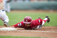 Arkansas Razorbacks second baseman Rick Nomura (1) dives back to first base against the Virginia Cavaliers in Game 1 of the NCAA College World Series on June 13, 2015 at TD Ameritrade Park in Omaha, Nebraska. Virginia defeated Arkansas 5-3. (Andrew Woolley/Four Seam Images)