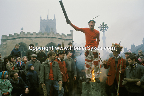 Haxey Hood Game. Haxey, Lincolnshire. Smoking the Fool. Peter Bee as The Fool.1970s. 1971