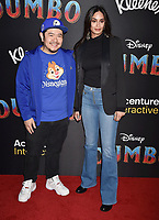 HOLLYWOOD, CA - MARCH 11: Eric Bauza (L) and Elishia Perosa attend the premiere of Disney's 'Dumbo' at El Capitan Theatre on March 11, 2019 in Los Angeles, California.<br /> CAP/ROT/TM<br /> &copy;TM/ROT/Capital Pictures