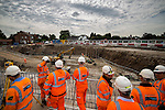 © Joel Goodman - 07973 332324 . 05/08/2016 . Cheshire , UK . Workers looking over the A6 relief road construction site , near to Manchester Airport , ahead of Chris Grayling's first visit to the North West since he was appointed Transport Secretary . Photo credit : Joel Goodman