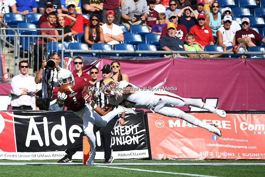 August 30, 2014 - Foxborough, Massachusetts, U.S. - Massachusetts Minutemen wide receiver Tajae Sharpe (1) can't make a reception while being covered by Boston College Eagles defensive back Justin Simmons (27) during the NCAA Division I football game between Boston College Eagles and the University of Massachusetts Minutemen held at Gillette Stadium in Foxborough Massachusetts. Eric Canha/CSM