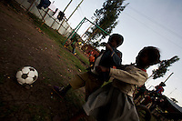 two  young guest of a  small orphanage play soccer in the orphanage's play ground in the outskirts of Addis Ababa, Ethiopia on Tuesday June 05 2007.
