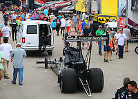 Apr 26, 2015; Baytown, TX, USA; A tow vehicle tows NHRA top fuel driver Larry Dixon through the pits during the Spring Nationals at Royal Purple Raceway. Mandatory Credit: Mark J. Rebilas-