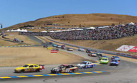 Jun. 21, 2009; Sonoma, CA, USA; NASCAR Sprint Cup Series driver Clint Bowyer (33) leads Ron Fellows (09) during the SaveMart 350 at Infineon Raceway. Mandatory Credit: Mark J. Rebilas-