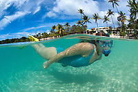 Split level image of a snorkeler<br />
