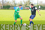 Tralee Athletic Colin Slattery  gets blocked by Dingle B Tony Lawlor at the Celsius Menswear Final in Mounthawk Park Dingle V Tralee Athletic on Sunday