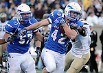 November 7, 2009:  Air Force running back, Jared Tew (#42), breaks away from tacklers during the annual battle between the Army Black Knights and the Air Force Falcons at Falcon Stadium, U.S. Air Force Academy, Colorado Springs, CO.  Air Force defeats Army 35-7.